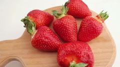 Fresh, ripe, juicy strawberries rotate. Stock Footage