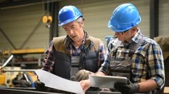 Engineers working on project in metallurgy manufacture - stock footage