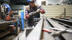 Metalworker in workshop Stock Footage