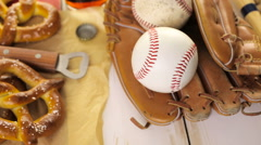 Close up of old worn baseball equipment on a wooden background. Stock Footage