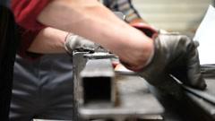 Metalworker measuring piece of metal Stock Footage