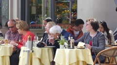 Milan Italy tourists people eating drinking in street restaurant in city center Stock Footage