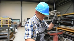Metalworker with hardhat working on machine - stock footage