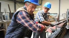 Engineers working in metallurgy warehouse - stock footage