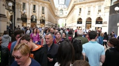 Crowd tourists in Milan Italy walking in Vittorio Emanuele shopping Gallery Stock Footage