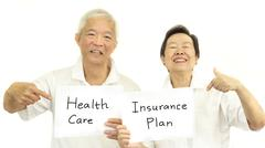 Happy Asian senior couple health care and insurance plan concept - stock photo