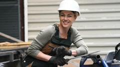 Woman working in metal industry workshop - stock footage