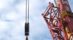 Detail of heavy crane that moves the blue sky with fluffy white clouds Stock Footage