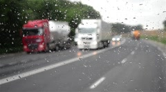 Heavy car traffic seen through a windscreen of the truck that was many splashing - stock footage