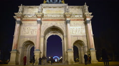 Tourists entering Tuileries Garden through triumphal arch in Place du Carrousel - stock footage
