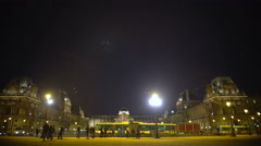Public transport passing Louvre Museum at night, people viewing Paris sight Stock Footage
