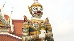 Giant statue around temple of dawn, wat Arun, landmark of Bangkok, Thailand Stock Footage