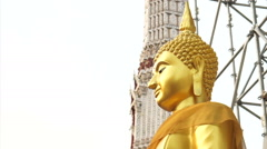 Golden Buddha statue construction scaffold and pagoda background Stock Footage