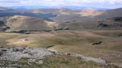 Aerial view on a mountain sheepfold and the mountains that surround it 01 Stock Footage