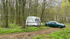 Life in freelance style on travel. Car with trailer, caravan in spring nature. 4 - stock footage