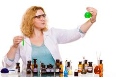 female chemistry student with glassware test flask. - stock photo