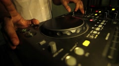 Hands of a DJ which spins and mixes music buttons during a concert, show, social - stock footage