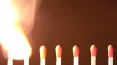Row of Red Matchsticks Burn Stock Footage