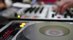 Hands of a DJ which spins and mixes music buttons during a concert, show, social Stock Footage