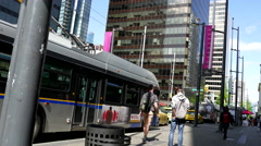 One side of people get off the bus at downtown Vancouver Stock Footage