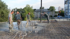 Builders, pouring the concrete, floor slabs. Stock Footage