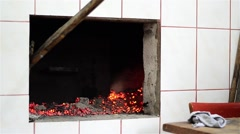 Chef who prepares the embers in the stove in order to put baking bread or other Stock Footage
