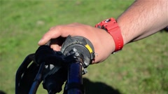 Man clutching the hand brake of a motorcycle Stock Footage