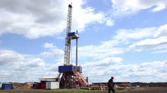 4K Timelapse clouds over drilling rig Stock Footage