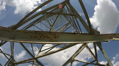 Rusty electrical pylon against blue cloudy sky, time lapse 4K Stock Footage