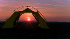 Sunrise and tourist tent. Symbol of travel life in 4K. Time lapse. RAW, without - stock footage