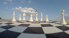 Chess board with figures and clouds concept, time lapse 4K Stock Footage