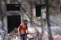 PREROV, CZECH REPUBLIC, JUNE 1, 2011: A Roma, gypsy man working in the ghetto Kuvituskuvat