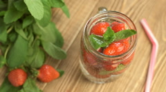 Fresh summer drink with strawberry and mint Stock Footage
