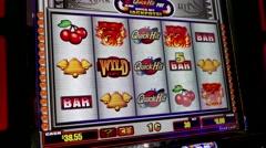 Close up woman playing slot machine screen inside Hard Rock Casino Stock Footage