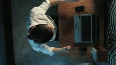 Businessman at laptop enjoys victory Stock Footage