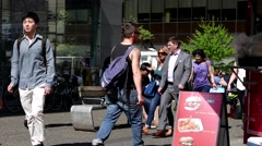 People walking and crossing the street at downtown Vancouver Stock Footage