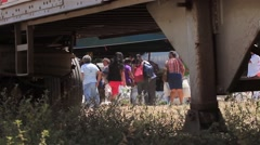 People carrying their bags of produce at a food drive in Panama - stock footage