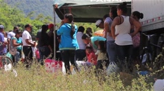 Line of people extending from a food drive in Panama - stock footage