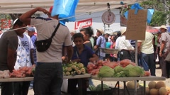 Vegetable stand at a government food drive in Panama - stock footage