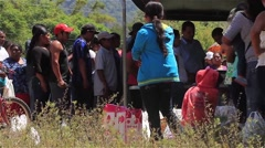 Large sacks being given to people at a Panamanian food drive - stock footage