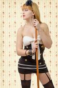 beautiful pinup girl at black stockings with a broom - stock photo