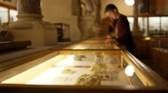 4K Mother & son in natural history museum looking into glass display case - stock footage