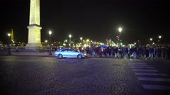 Crowd of pedestrians crossing street, leaving Place de la Concorde, night Paris - stock footage