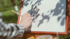 Girl draws on nature_ Stock Footage