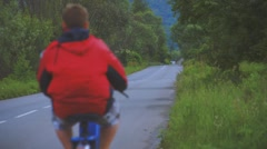 Boy Riding Motor Scooter On Road Stock Footage