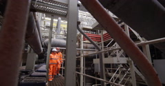 4K Male & female engineers conducting checks inside power plant - stock footage