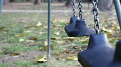 Two empty swings dangling Stock Footage