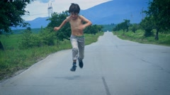 Running on the road Stock Footage