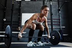 Young weight lifter - stock photo