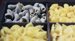 Italian pasta assortment grades background - stock footage